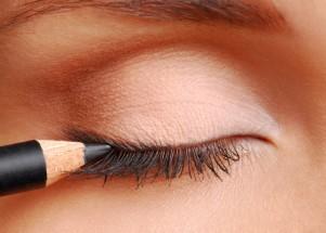 Woman applying eyeliner